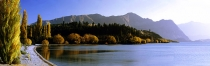 Panorama_of_Dublin_Bay_Lake_Wanaka_Central_Otago_during_autumn___glowing_autumn_fall_colours,_golden_poplar_trees_Mt_Roy_and_Treble_Cone_in_distance