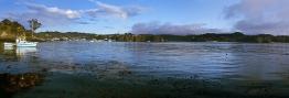 Boats_at_Anchor_Rakiura_Stewart_Island_from_Lonnekers_Beach_Oban_Halfmoon_Bay_Township_in_background