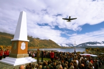P_40_Curtiss_KittyHawk_flying_over_Anzac_Parade_Wanaka_Cenotaph_as_last_post_is_being_played