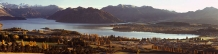 Panorama_of_Wanaka_Lake_Township_in_Autumn_from_beneath_Hillend_showing_Roys_Bay,Minaret_Peaks,_Mt_Burke_and_Mt_Maude
