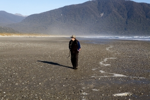Photo_of_Tramper_on_Beach_at_Big_Bay_Awarua_Bay_Te_Wahi_Pounamu_West_Coast_South_Island_Southern_Alps
